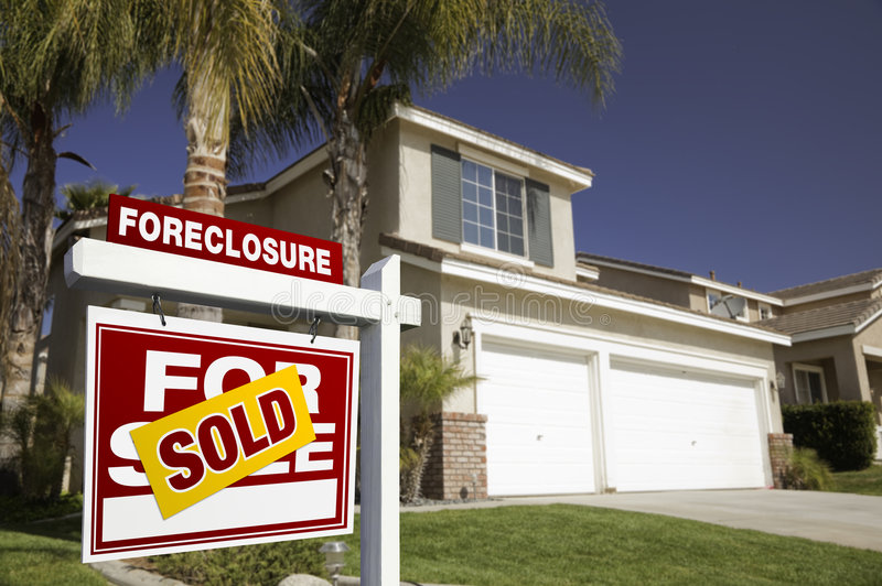 Red Foreclosure For Sale Real Estate Sign and Hous. Red Foreclosure For Sale Real Estate Sign in Front of House stock photos