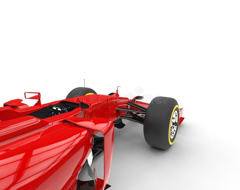 Red formula one car - focus on front wheels. Isolated on white background stock photo