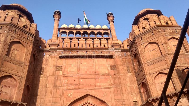 RED FORT FLAGE INDIA DELHI. The Red Fort is a historic fort in the city of Delhi in India, which served as the main residence of the Mughal Emperors. Every year royalty free stock photo