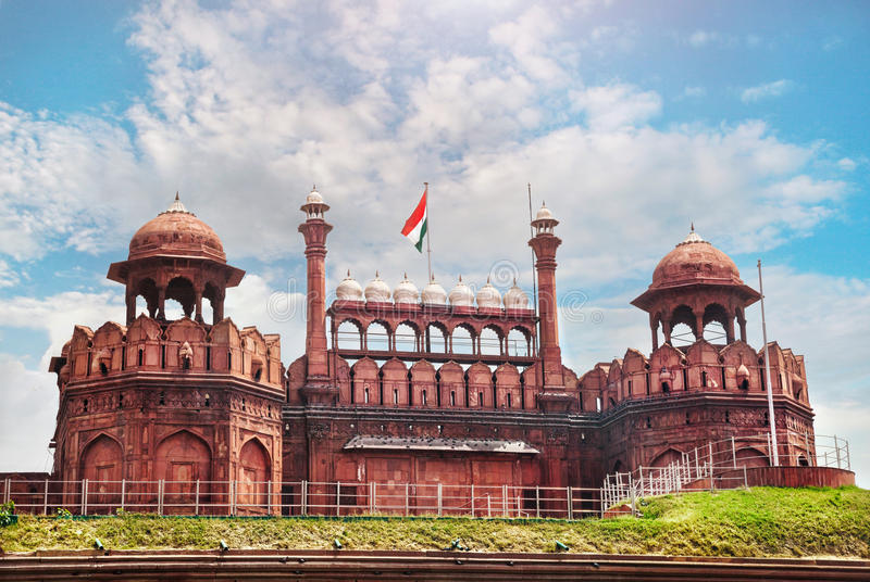 Red fort in India. Lahore Gate of Red Fort with Indian national flag at blue sky in Old Delhi, India stock photography