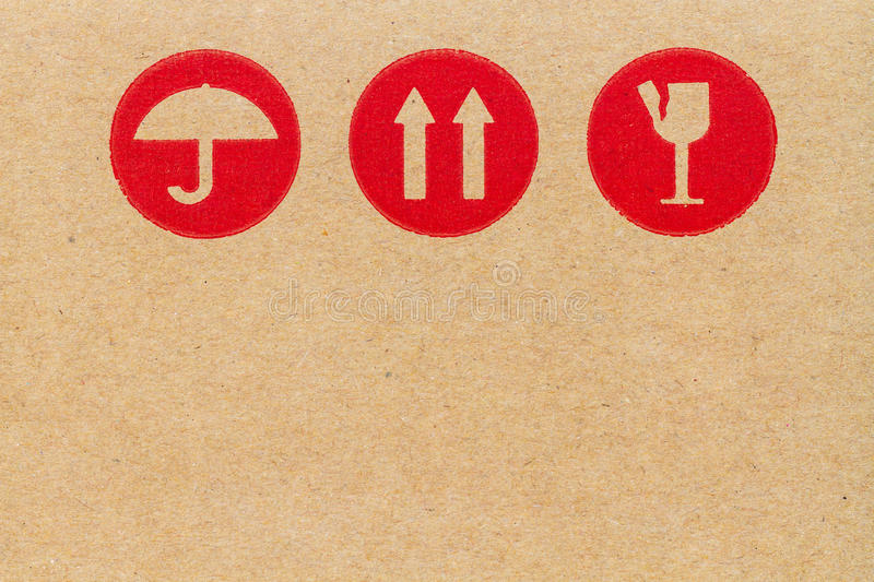 red fragile symbol on cardboard. stock photos