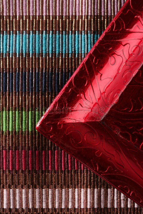 Download Red Frame Corner Over Multi Color Tablecloth Stock Photo - Image: 7852644