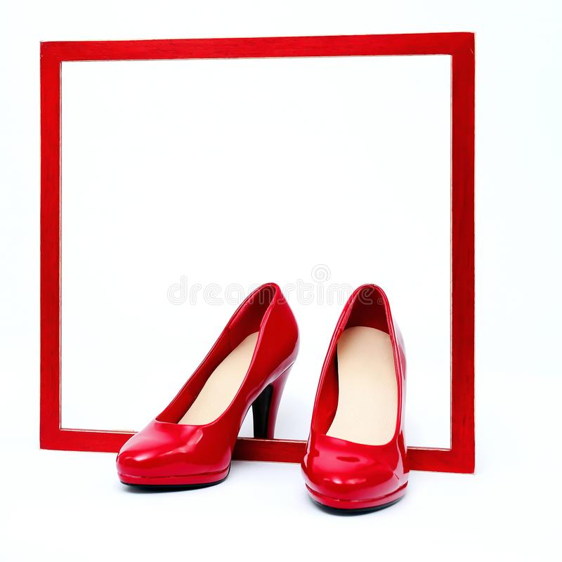 Red frame with high heels. In front of white background stock photography