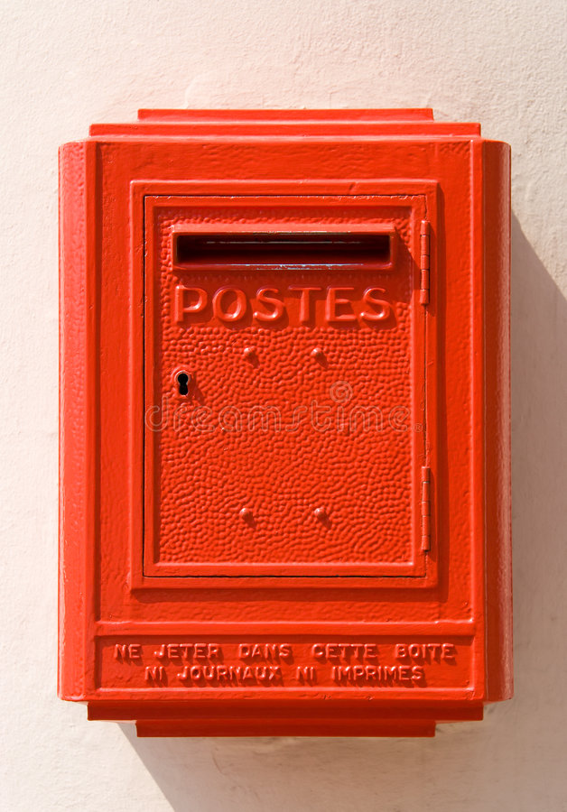Red French mail box on a wall stock image