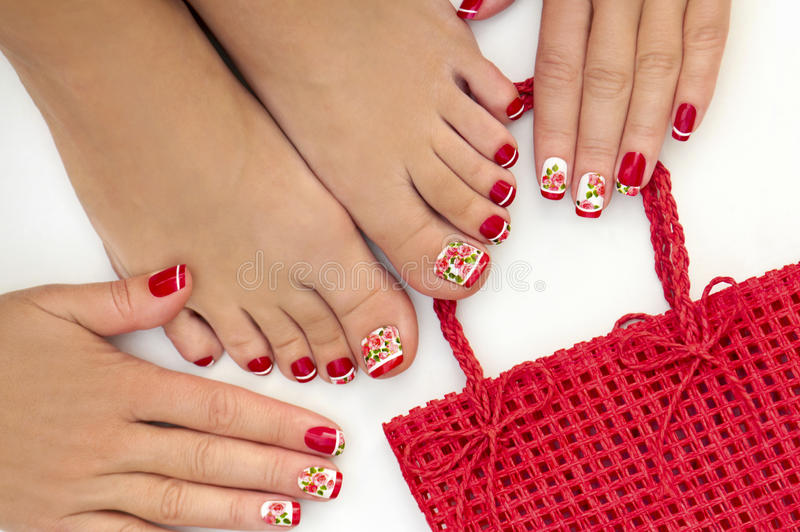 Red French manicure and pedicure. stock photos