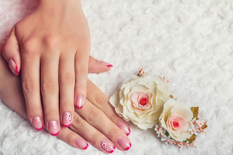 Red french nail art with flower stock photography
