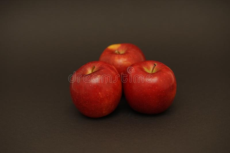 Red fresh apples on black background. Food photography. apple capture in flash light royalty free stock photography