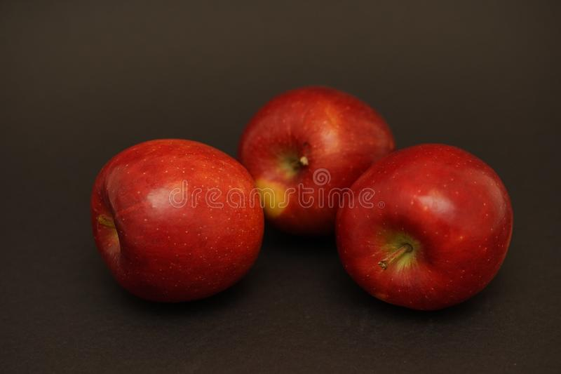 Red fresh apples on black background. Food photography. apple capture in flash light royalty free stock photos