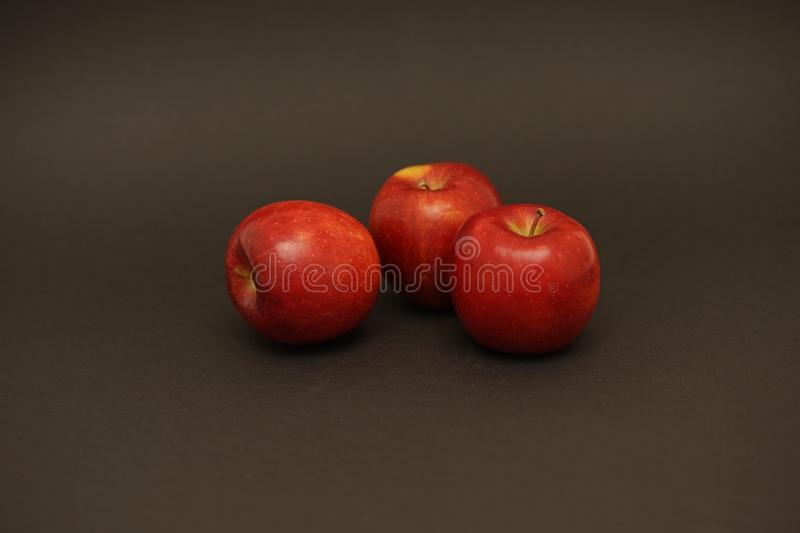 Red fresh apples on black background. Food photography. apple capture in flash light stock photos