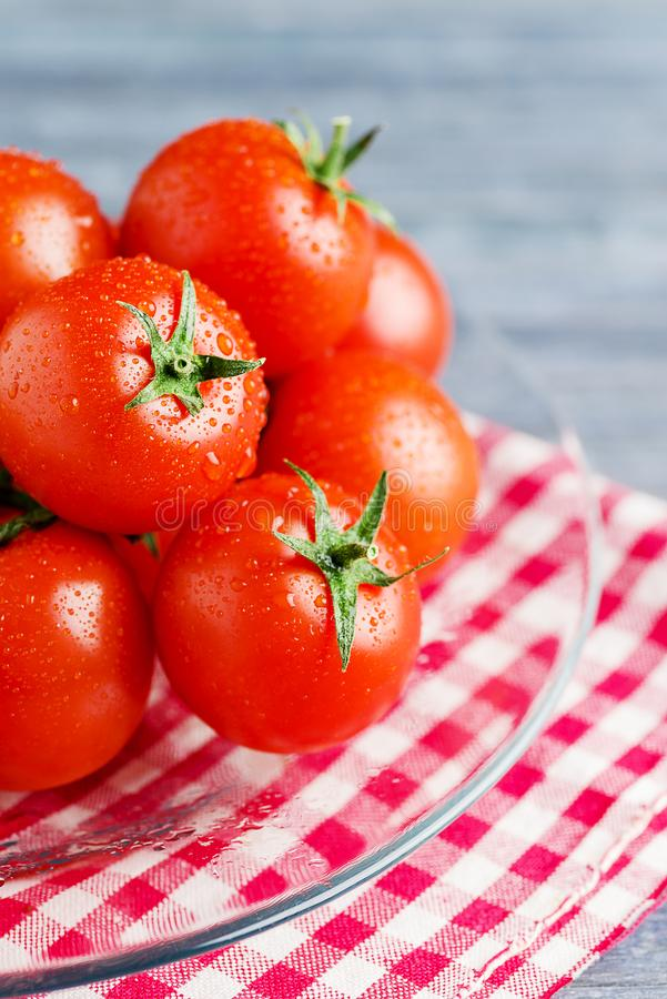 Red fresh tomatoes on trasparent dish. Fresh tomatoes on trasparent dish stock photography