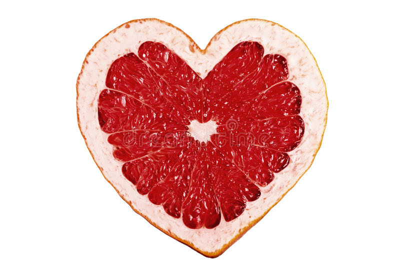 Red fruit heart. Citrus close-up stock photo