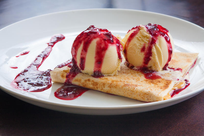 Red Fruits Crepe. Stuffed with dulce de leche royalty free stock photography