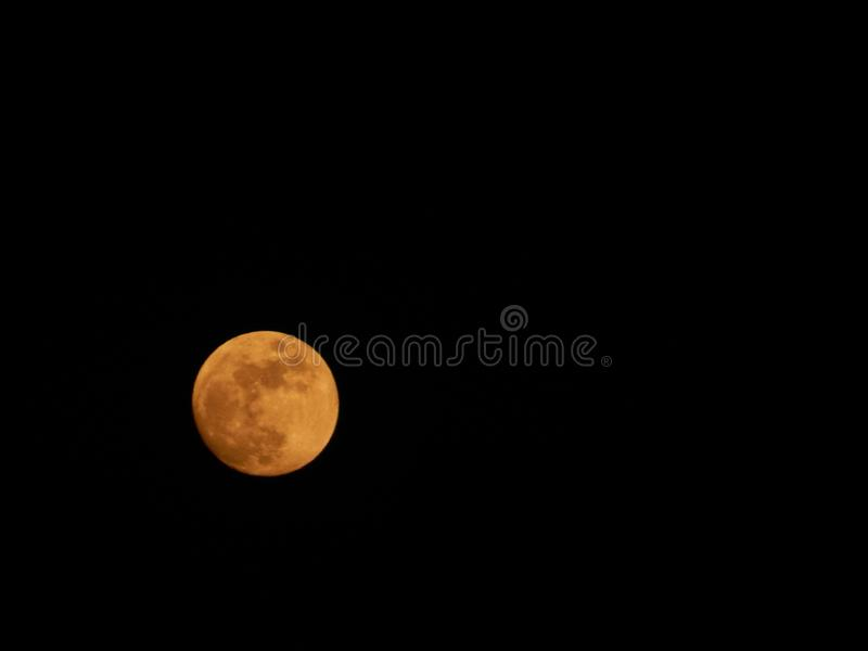 Red full MOON with dark spot royalty free stock photo