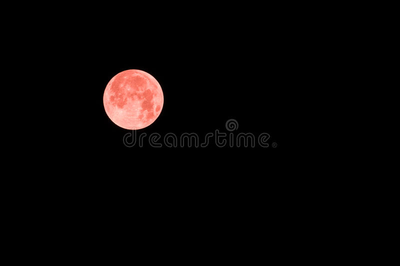 Red full moon in red color also called bloodmoon. Florence, Italy - September 2015 - Blood Red Moon during Lunar eclipse. Italy, 2015 royalty free stock image
