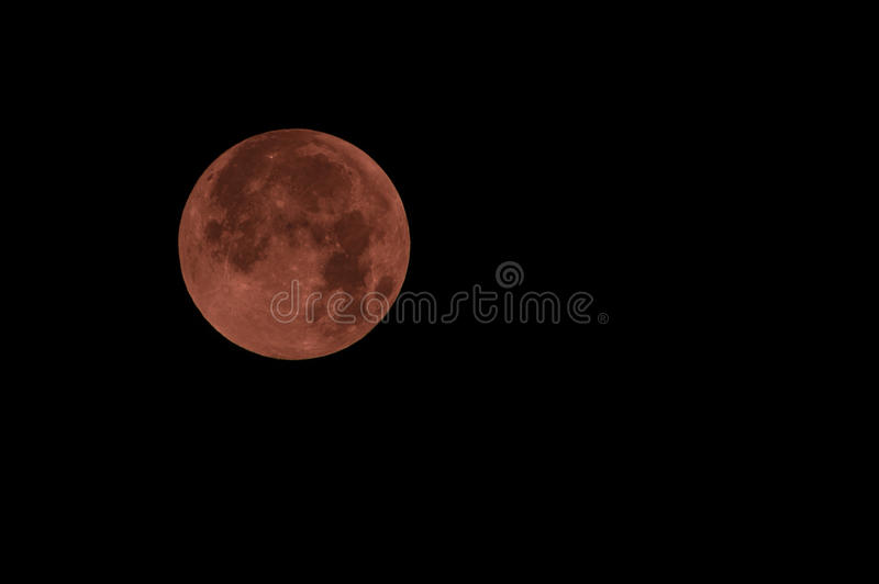 Red full moon in red color also called bloodmoon. Florence, Italy - September 2015 - Blood Red Moon during Lunar eclipse. Italy, 2015 royalty free stock photo