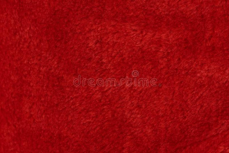 Red fur texture background. Wool soft cotton surface stock photos