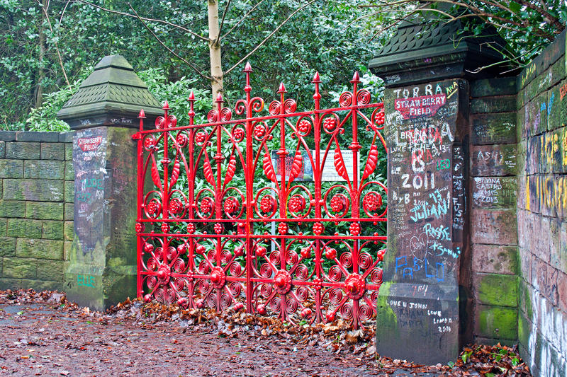 Red gates at the entrance to Strawberry Field royalty free stock photo