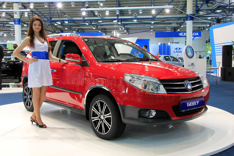 Red Geely MK Cross. KIEV - MAY 26: Red Geely MK Cross at yearly automotive-show SIA 2011. May 26, 2011 in Kiev, Ukraine royalty free stock images