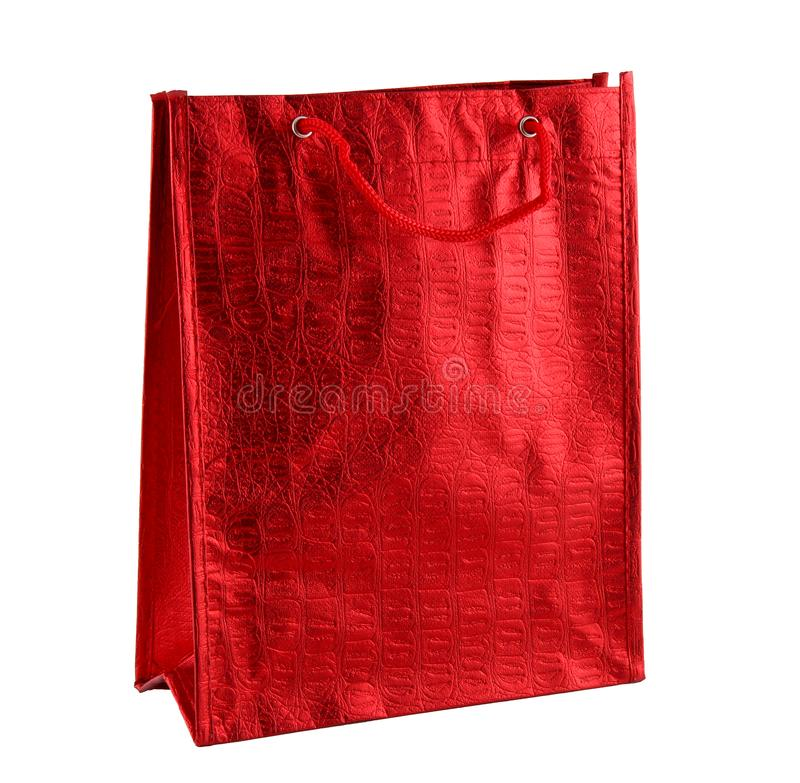Red gift bag isolated on the white background. It is a big bag with an embossed pattern. It is intended for shopping or for. Discounts and sales. It has a red royalty free stock image