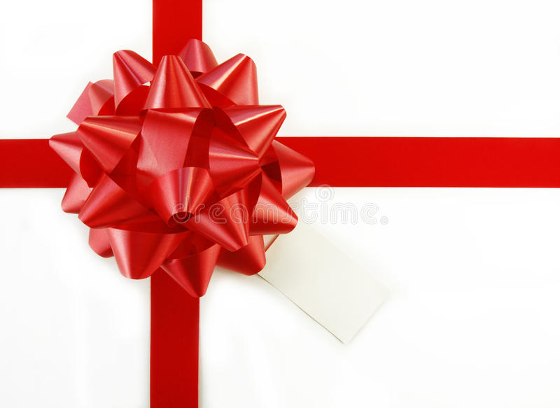 Red Gift Bow and Tag on White Box royalty free stock image