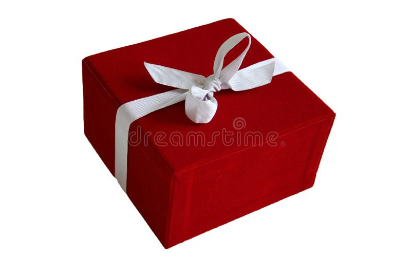 Red Gift Box. Tied with a white silk bow stock photo