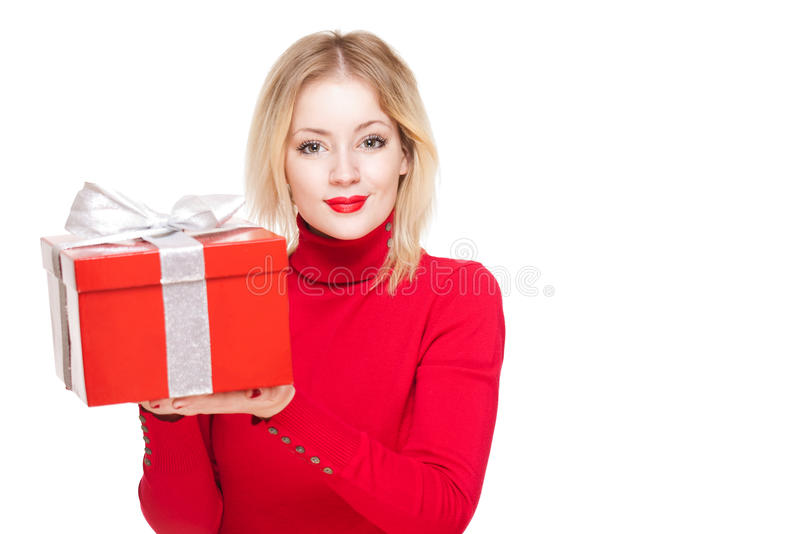 Red gift box cutie. Portrait of a beautiful young blond woman holding shiny red gift box royalty free stock images
