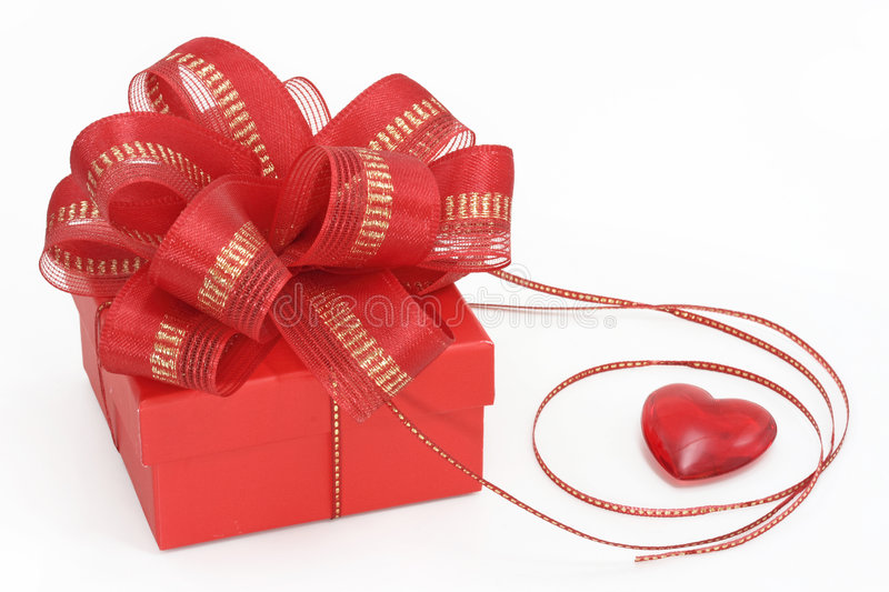 Red gift box with heart royalty free stock photography