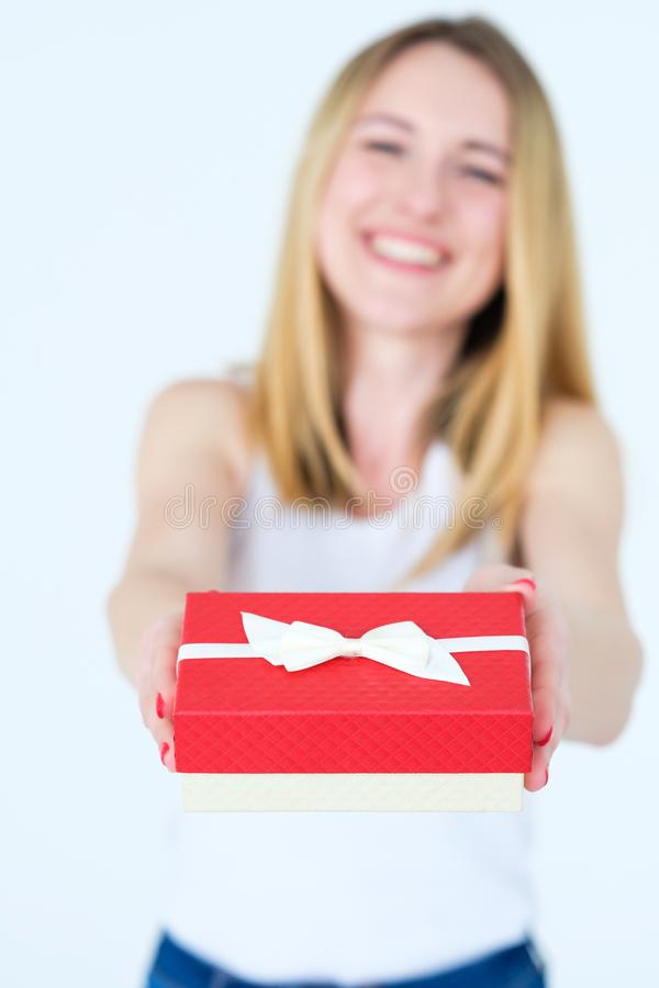 Red gift box holiday present anniversary reward. Red gift box in womans hands. holiday present or happy anniversary reward for a loved one royalty free stock photo