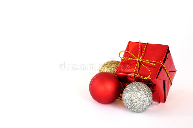 Red gift box and ornaments isolate on white background stock photography