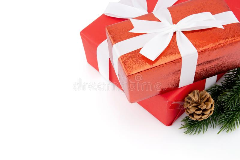 Red gift box with pine and pinecone in season Christmas and new year isolated on white background stock photos