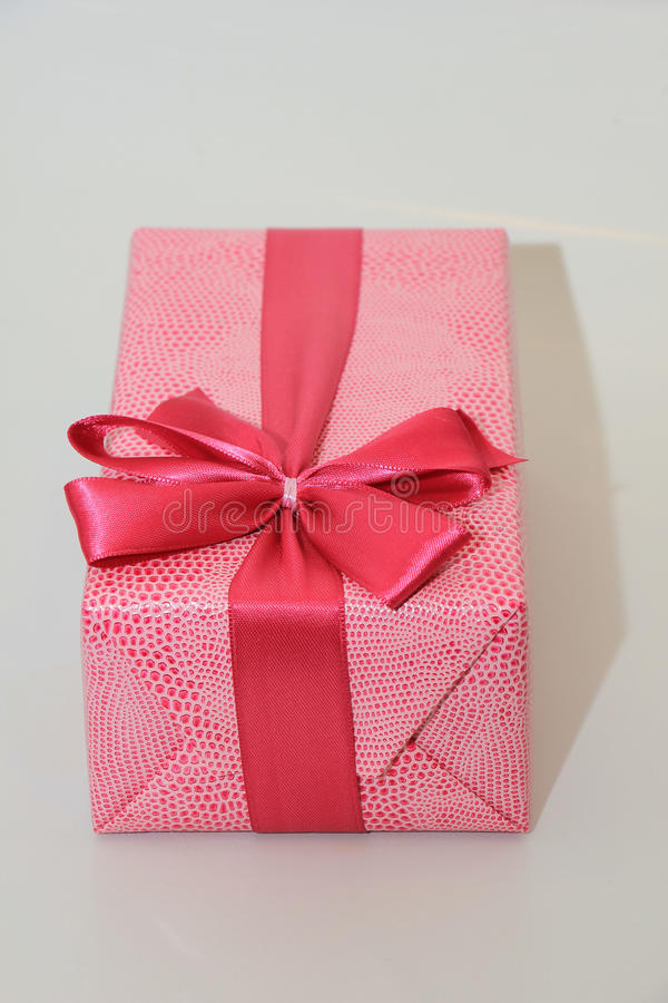 Red gift box with ribbon and bow. Perfect wrapped gift box with ribbon and bow royalty free stock photos