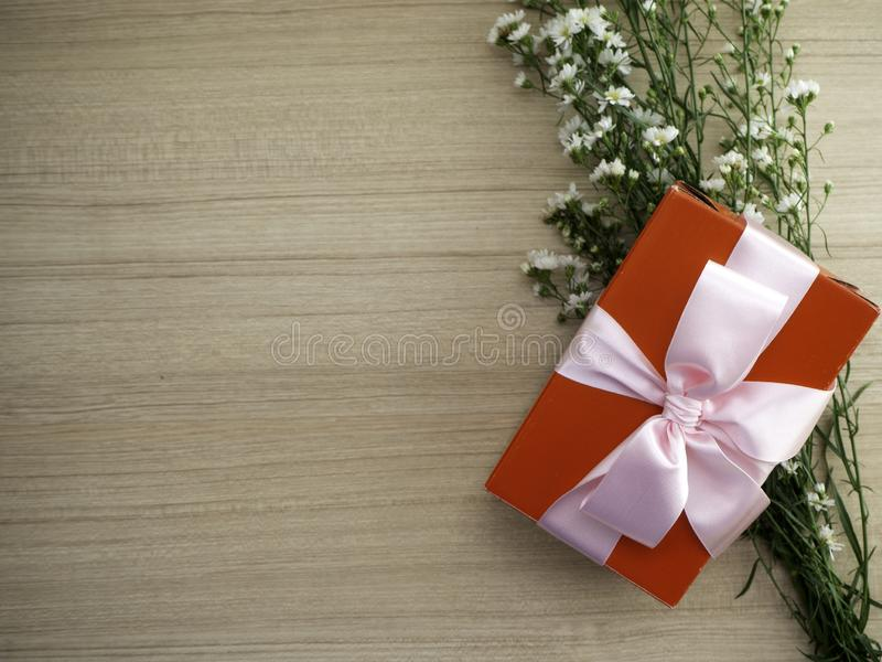 Red gift box tied with pink ribbon stock images