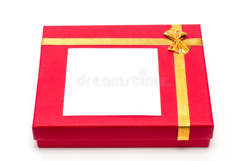 Red gift box on white background. Beautiful packaging. A gift to a girl, a woman. For you. A piece of paper on a beautiful box stock photo