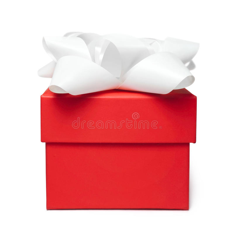 Red gift box with white bow. Isolated on white royalty free stock images