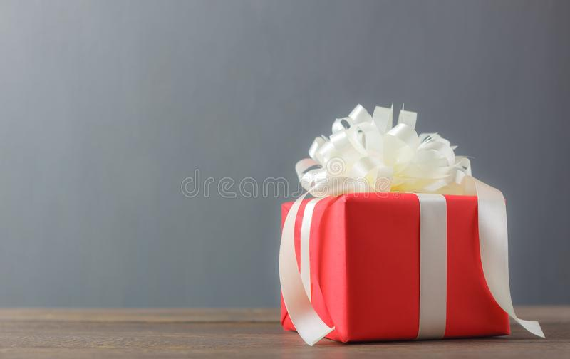Red gift box and white bow with ribbon.accessories Happy new year or Happy Birthday or Merry Christmas concept. royalty free stock photography