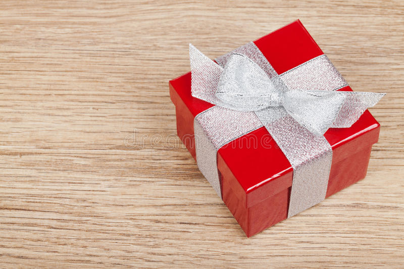 Red gift box. On wooden table background. View from above with copy space royalty free stock photo