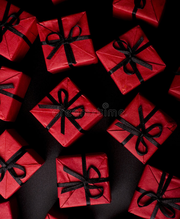 Red gift boxes on black stock image