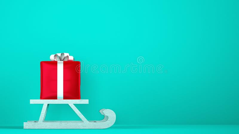 Red gift package on Christmas sleigh with cyan background. Red Christmas gift on the white sledge stock photography