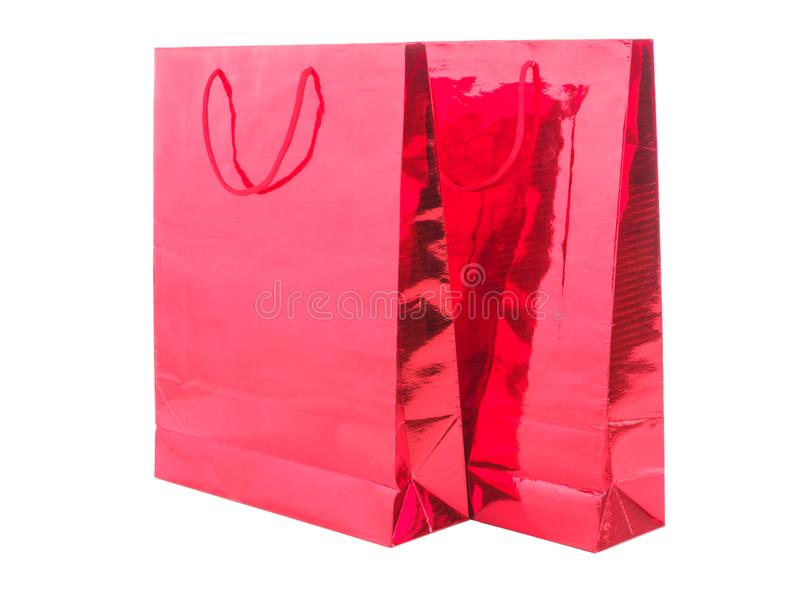 RED GIFT PACKAGE ON WHITE BACKGROUND. Colourful paper shopping bags isolated on white royalty free stock images