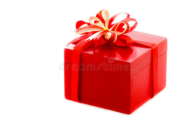 Red gift. With a red ribbon and a bow stock photos
