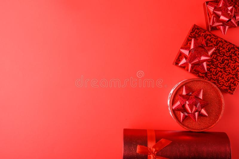 Red gifts on a red background, with space for congratulation. Love day, Valentine`s day, birthday or Christmas royalty free stock images