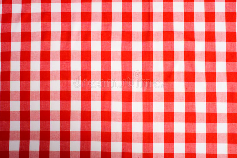 Red Gingham Background. Red and white Gingham or checked tablecloth background royalty free stock photo