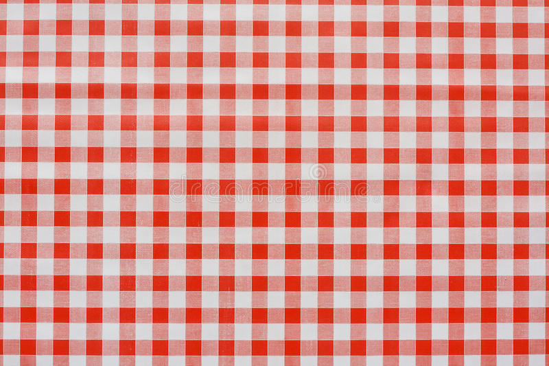Red Gingham tablecoth background. Red gingham tablecloth often found in diners and cafes a popular traditional covering for tables where food is consumed stock image