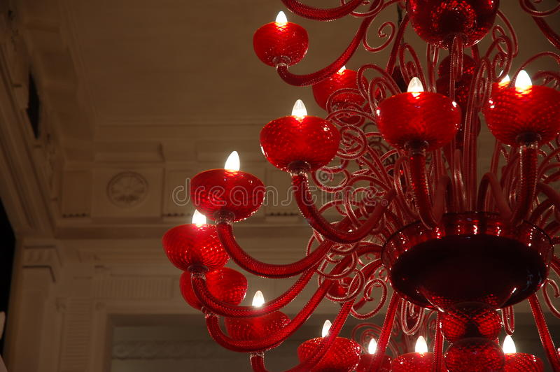 Red glass chandelier. Luxuryand classy red glass chandelier stock images