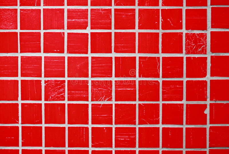 Red glazed tile. In the kitchen royalty free stock images