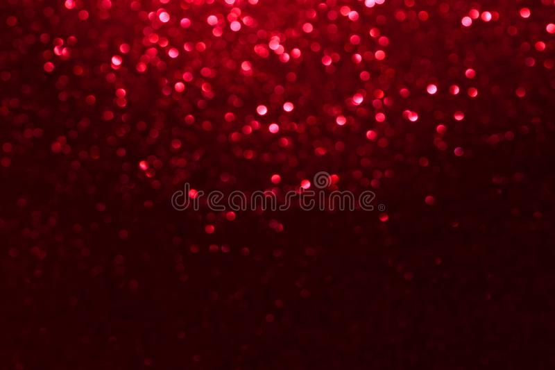 Red glitter bokeh lights Blurred abstract background for Valentines, birthday, anniversary, wedding, new year and Christmas.  stock photo