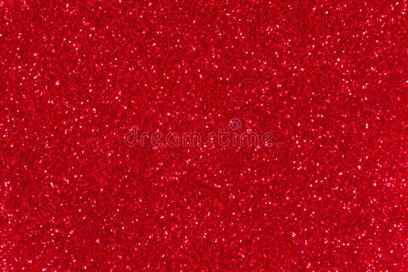 Red glitter texture. Abstract twinkle background for New Years or Christmas holiday. Red glitter background. Sparkle texture. Abstract twinkle background for stock photo