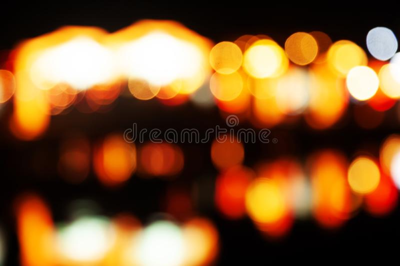 Red glitter vintage lights background. defocused, abstract festive, blured street lights royalty free stock photos