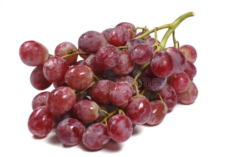 Red grapes bunch close up isolated white background. Bunch of red globe grapes against white background royalty free stock photo