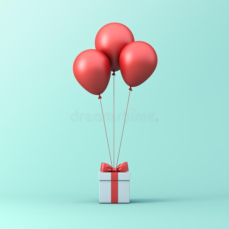 Red glossy balloons tied to gift box or present box with red ribbon and bow isolated on light green blue pastel color background stock photos